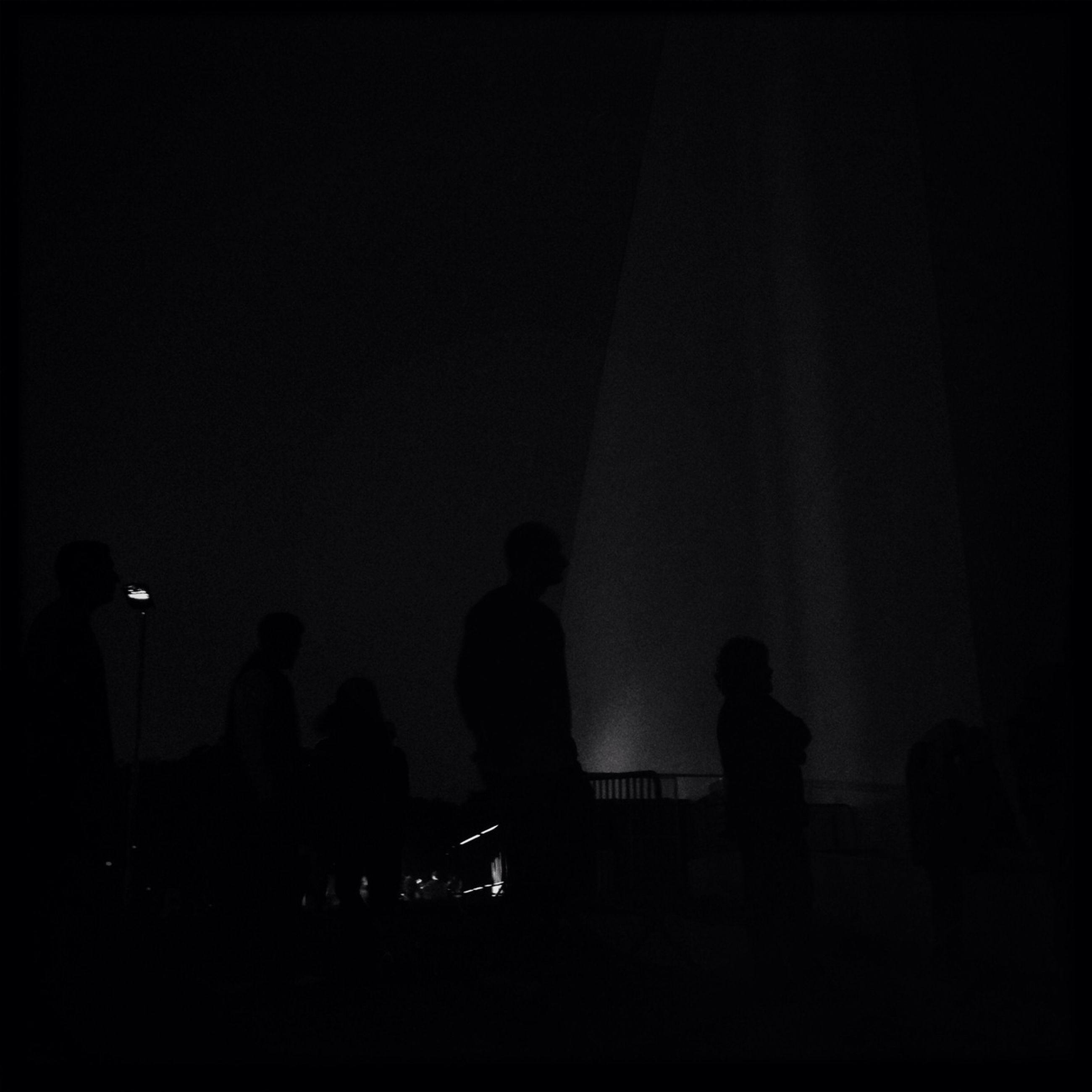 silhouette, men, lifestyles, night, person, dark, large group of people, leisure activity, copy space, illuminated, outline, standing, group of people, togetherness, unrecognizable person, medium group of people, indoors, walking