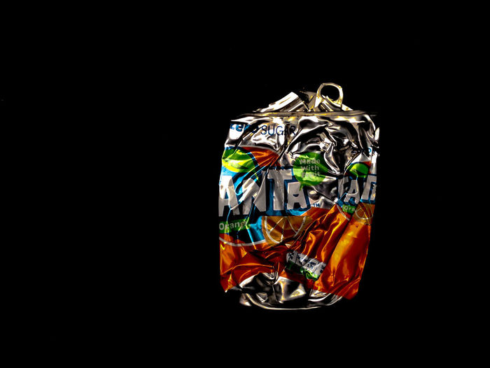 Fanta Crumpled Fanta Abundance Aluminium Can Black Background Business Close-up Consumerism Copy Space Creativity Cut Out Excess Expense Indoors  Luxury Metal Multi Colored No People Reflection Shiny Single Object Still Life Studio Shot Wealth