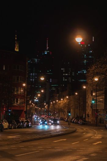 Illuminated city street and buildings at night