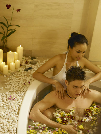 Girlfriend Giving Massage To Boyfriend In Bathtub