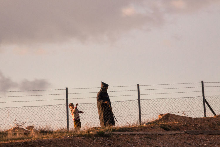 Morocco, daily life scene in the countryside. Country Life Fatherandson Fence Morocco Outdoors Roadphotography Sky Traditional Clothing