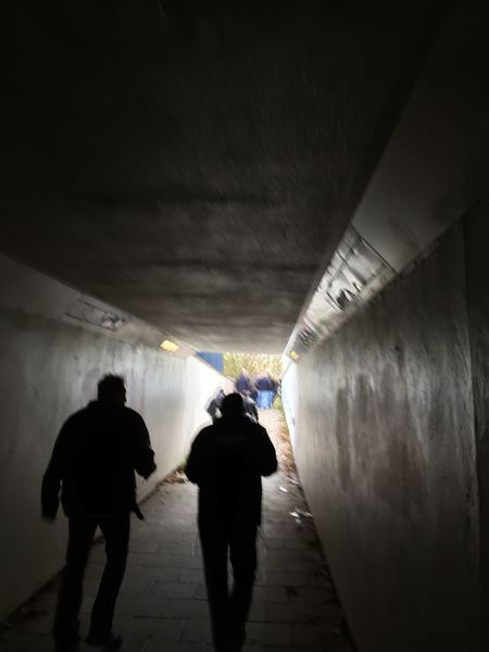 Adult Architecture Day Illuminated Indoors  Leisure Activity Lifestyles People Real People Rear View Silhouette The Way Forward Tunnel Walking Warm Clothing