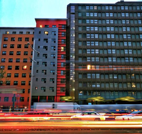 City City Street Building Exterior Cityscape Office Building Exterior Architecture Illuminated Urban Skyline Downtown District Outdoors City Life Business Finance And Industry Built Structure Huawei Photography EyeEm Best Shots EyeEm Selects Light Painting Long Exposure Shot P10 Plus Photography Oo Motion Low Angle View Blurred Motion Light Trail Car Light Trails