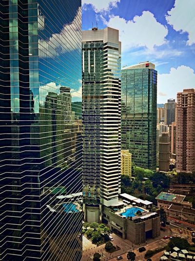 Would not mind having a view like that from work. (Pacific Place, Hong Kong) Office Building Building Exterior Buildings Blue Sky Enjoying The View Reflection Skyscrapers HongKong Aerial View Architectural Detail Architecture Skyscraper Cityscapes Glass Sky And Clouds Urbex Window Urban Landscape Check This Out