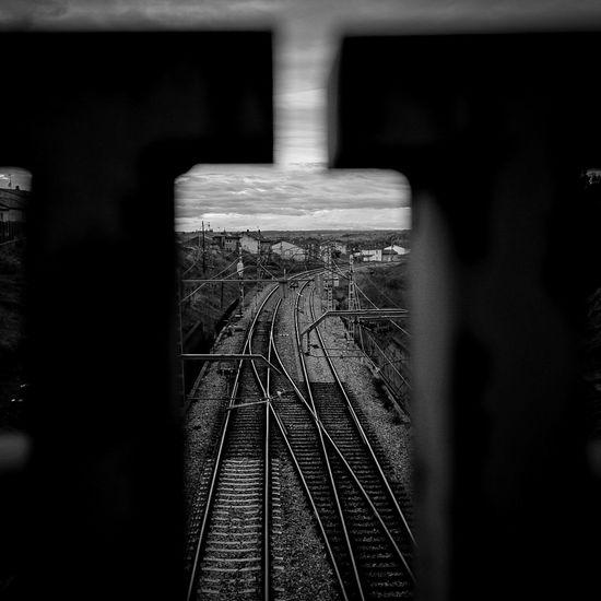 Railroad tracks seen through train
