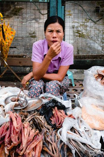 Woman holding fish at market