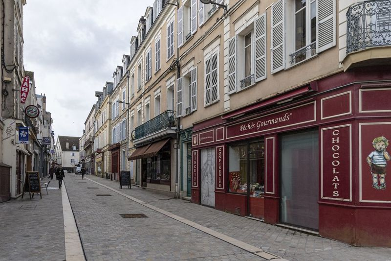 Chartres City France Architecture Building Building Exterior Built Structure City Day Direction Footpath Incidental People Outdoors Residential District Sidewalk Street The Way Forward Tourism Destination Town Travel Destination Window