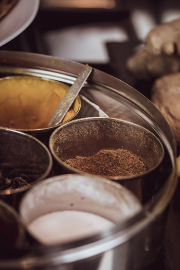 A selection of ingredients and food items at a kitchen - Indian cuisine. Food And Drink Food Indoors  Still Life Selective Focus Freshness Container Close-up No People Kitchen Utensil Variation Spice Choice Large Group Of Objects High Angle View Brown Eating Utensil Metal Wellbeing Spoon Indian Cuisine Curry