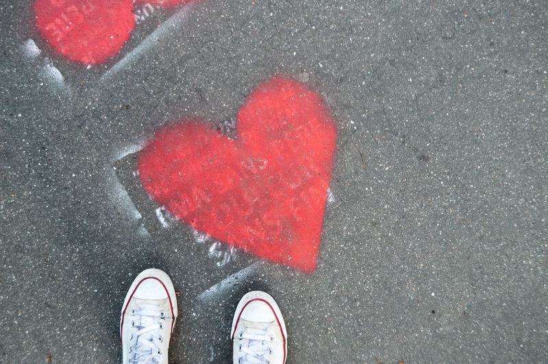 Love runs the streets Outdoors Street Streetphotography Heart Shape Heart Red Red Color Converse Shoes Ground Love Community Travel Shoe Low Section Human Body Part One Person Personal Perspective Standing Positive Emotion Body Part High Angle View Human Leg Directly Above Real People Road Emotion City Day Human Foot Drawing Creativity Art Textured  Shape The Art Of Street Photography My Best Photo The Minimalist - 2019 EyeEm Awards