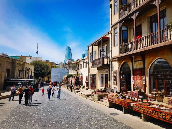Beautiful Baku shot on Iphone Baku Azerbaijan Travel Building Exterior Built Structure Architecture City Group Of People Street Building Sky Real People Nature Outdoors The Traveler - 2018 EyeEm Awards