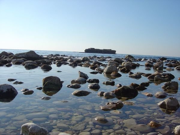 Beach Beauty In Nature Blue Byblos,Lebanon Clear Sky Copy Space Horizon Over Water Idyllic Nature Pebble Reflection Rock Rock - Object Scenics Sea Sea And Sky Shore Stone Stone - Object Tranquil Scene Tranquility Water