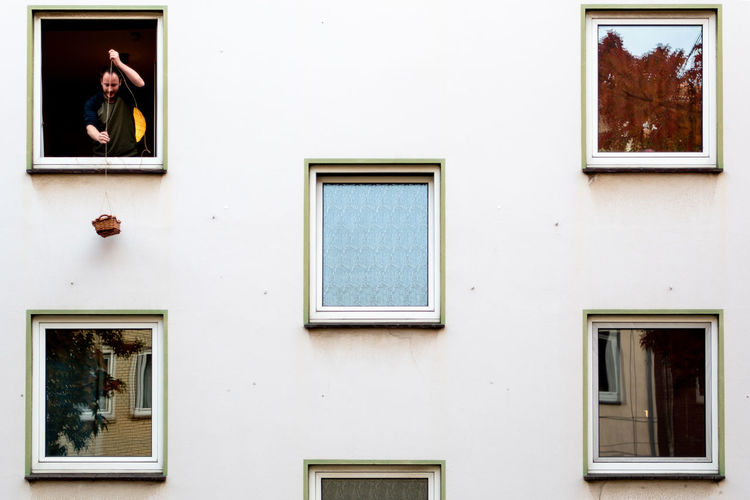 Low angle view of windows on wall of building