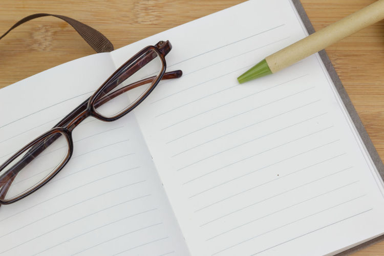 Blank book with pen and eyeglasses Pen Spectacles Blank Copy Space Copy Space Copyspace Backgrounds Background Book NotePad Eyesight Eyeglasses  Eyewear Reading Glasses Table Wood - Material High Angle View Education Paper Sunglasses Full Frame Fountain Pen Ballpoint Pen Lined Paper Spiral Notebook