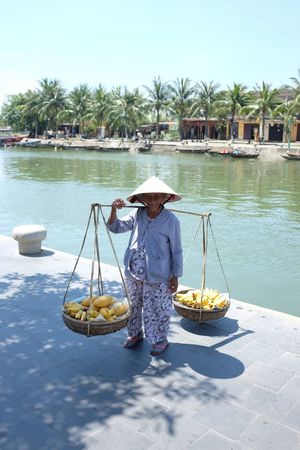 Banana Food Vendor Hard Work Hoi An Vietnam Vietnamese Working Asian Style Conical Hat Day Food Fruit Hat Holding One Person Outdoors People Real People Sun Hat Transportation Vendor Water Women