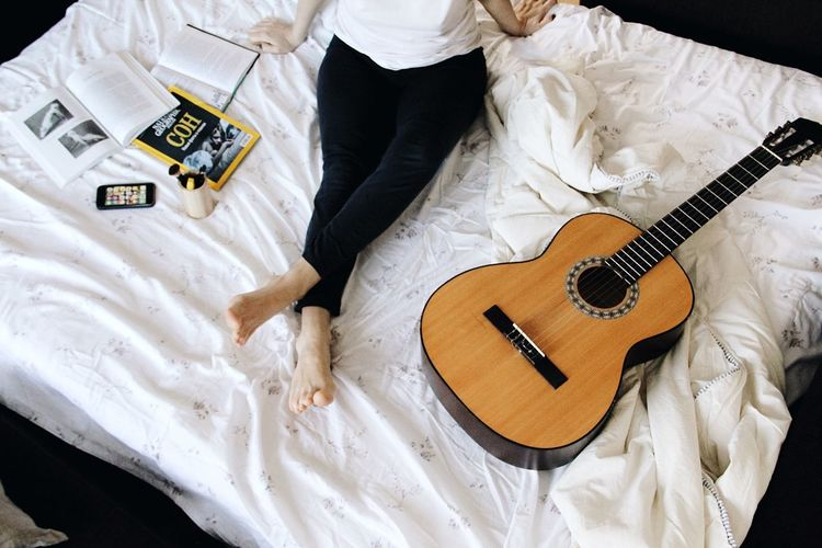 Relax Weekend Vacations Relaxing High Angle View Guitar Indoors  String Instrument Music Musical Instrument Still Life White Color Musical Equipment Textile Creativity Furniture Home Interior Domestic Room Playing Arts Culture And Entertainment Midsection Paper No People Bed