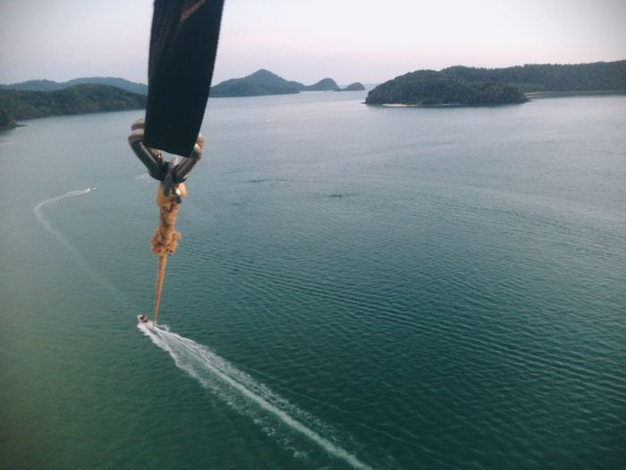 High angle view of rope in sea against sky