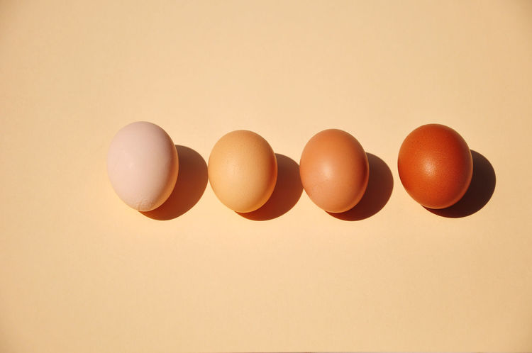 High Angle View Of Four Brown Eggs Horizontal In A Row The Week On EyeEm Animal Egg Brown Color Close-up Color Image Dairy Product Egg Food Food And Drink Four Objects Fragility Freshness Healthy Eating High Angle View Indoors  Ingredient No People Photography Raw Food Studio Shot