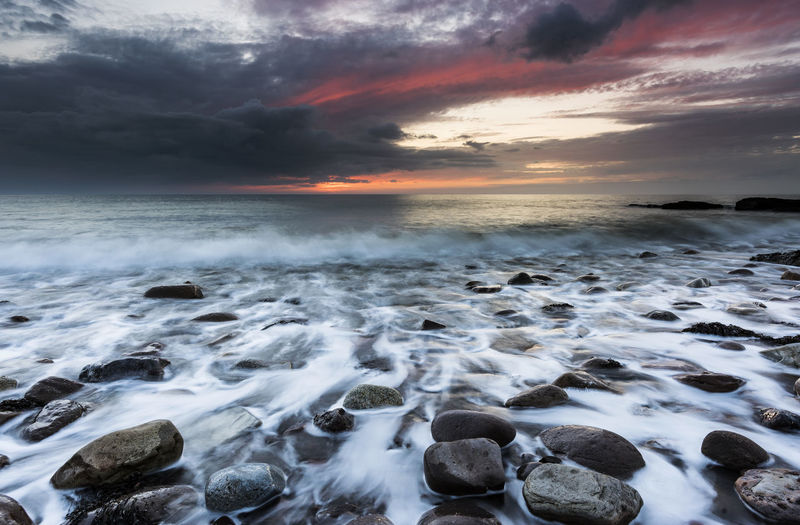 Sunset over the Cumbrian coast as the sky burst into colour Holiday Moody Sky Peace Rugged Travel Weather Beach Brochure Coast Dusk Evening Fire No People Pebbles Red Sky Rocks Seascape Shore Storm Cloud Sun Sunset Tide Waves