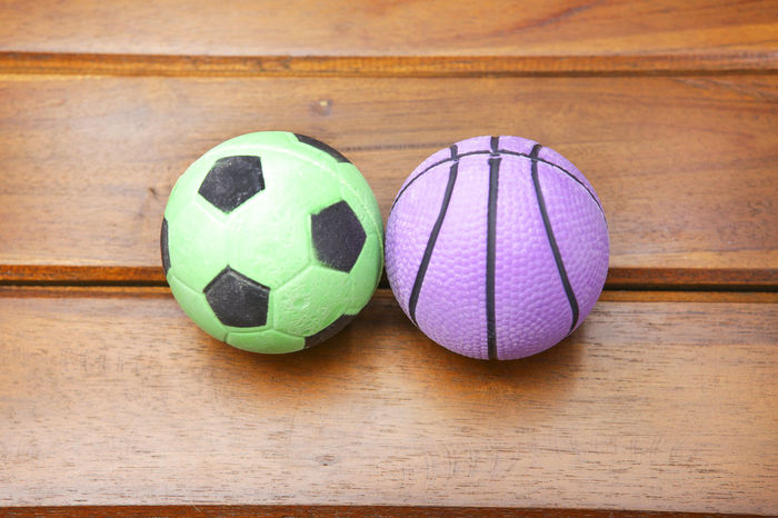 Rubber ball in wooden table Green Color Wood Ball Close-up Focus On Foreground Game Indoors  Kid No People Purple Rubber Rubber Ball Soccer Soccer Ball Sphere Sport Sports Equipment Still Life Table Tables Tabletop Team Sport Toy Wood Wood - Material