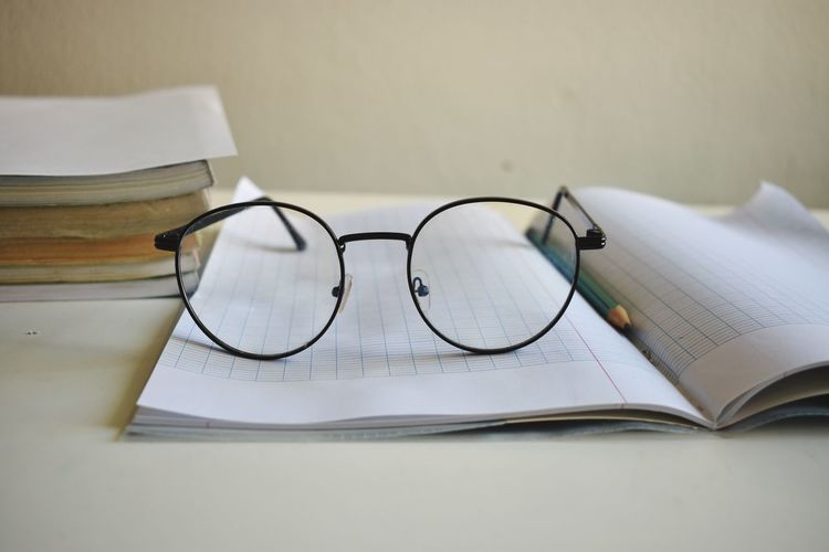Close-up of eyeglasses on book