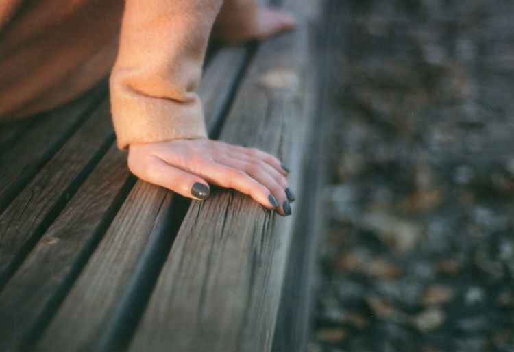 35mm Film Analogue Photography Adult Body Part Close-up Day Hand Human Body Part Human Hand Nail One Person Outdoors Relaxation Selective Focus Wood Wood - Material
