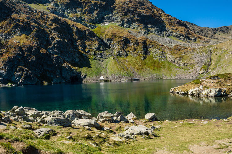 Seven Rila Lakes, Bulgaria The Eye Окото (Okoto) 2,440 m (8,010 ft) 6.8 ha (17 acres) 37.5 m (123 ft) Named after its oval shape. Deepest cirque lake in Bulgaria Water Rock Beauty In Nature Mountain Rock - Object Scenics - Nature Solid Lake Tranquility Tranquil Scene Nature Day Non-urban Scene Rock Formation No People Plant Reflection Tree Mountain Range Outdoors Formation Nature Nature_collection Nature Photography Beauty In Nature