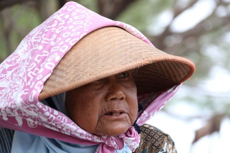 Close-up of senior woman with pink hat
