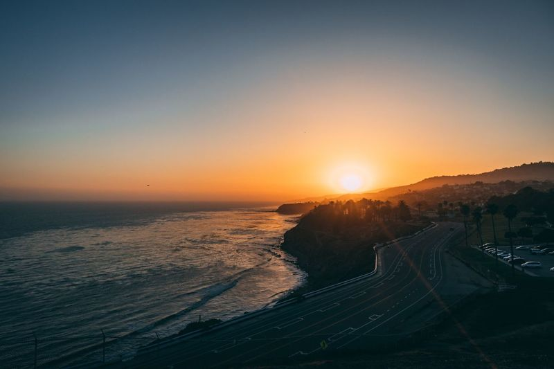 Cliffs And Water Road Cliff Los Angeles, California California EyeEm Selects Sky Sunset Beauty In Nature Sea Scenics - Nature Water Horizon Over Water Sunlight Horizon Sun Tranquility