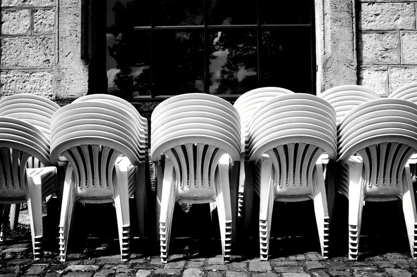 open Air Stacking Waiting For Someone Plastic Chair Equipment Cinema Blackandwhite Pattern Atmospheric Mood Still Life Close-up Backgrounds Pattern, Texture, Shape And Form Structures Shadows & Lights Shadowplay EyeEm Best Shots EyeEm Selects EyeEm Best Shots - Black + White EyeEm Masterclass Chairs Cinema Chairs Stacked Stacked Chairs Full Length Architecture Repetition Amphitheater