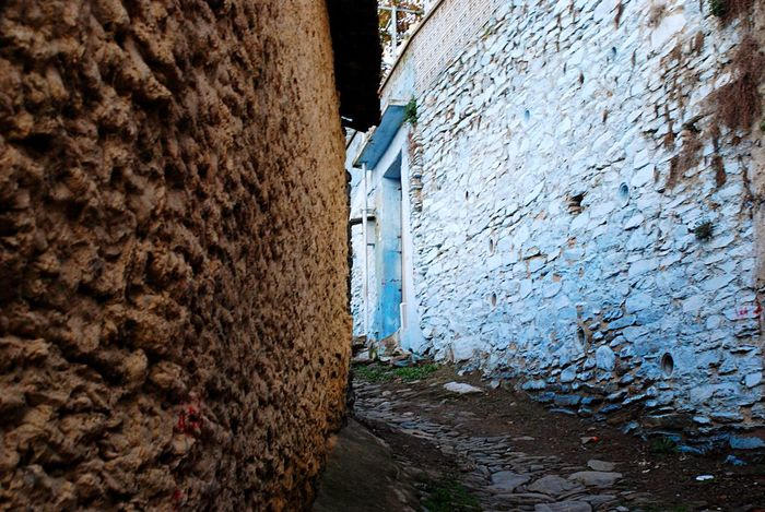 Narrow Street Paved Road Pavedstreet Stone Walls Blue Wall Paved Path Narrow Street Paved Blue Stone Wall Brown Travel Travel Photography Village Turkish House The Secret Spaces