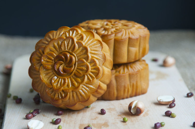 Close-up of moon cakes with seeds on cutting board