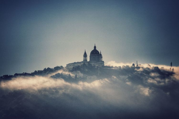 Church on building against sky