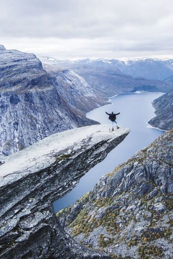 Trolltunga few. Norway🇳🇴 Trolltunga Warm Clothing Been There. Done That. Lost In The Landscape Scary Snow Cold Temperature Winter Day Nature High Angle View Frozen Outdoors Mountain One Animal View Adventure No People Beauty In Nature Photographer Aerial View Animals In The Wild Beauty In Nature An Eye For Travel Love Yourself
