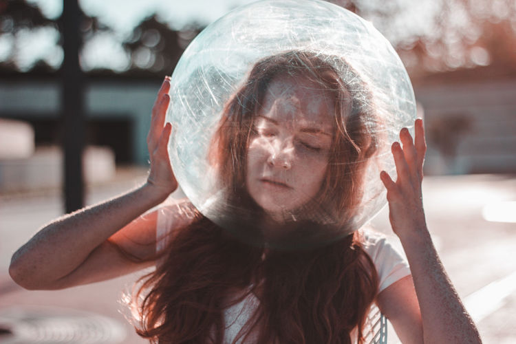 Young woman wearing glass helmet in head during sunny day