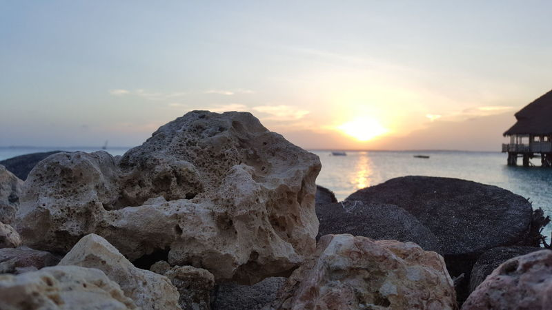 Sea Water Sunset Beach Rock - Object Relaxation Nature Reflection Vacations Beauty In Nature Coastal Feature Beauty Sun Landscape Summer Outdoors Scenics Sky Zanzibar_Tanzania Silhouette Tranquility Beauty In Nature