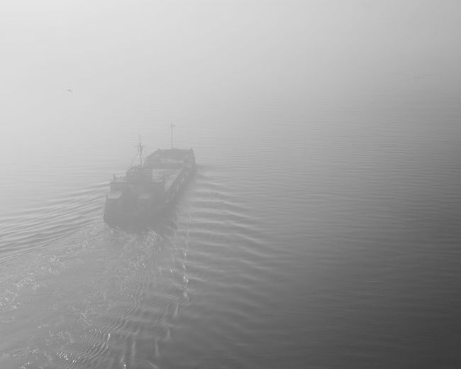 Voyage Into Mystery Water Nautical Vessel Transportation Waterfront Mode Of Transportation Sea Fog No People Travel Ship Tranquility Reflection Blackandwhite Black And White