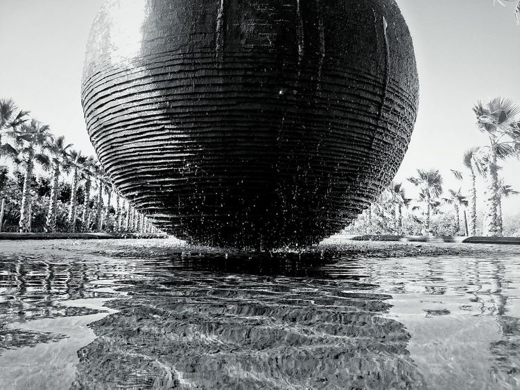 Monochrome Photography Lake Fountain Sculpture Contemporary Art Water Tranquil Scene Palm Tree Day Nature Sky Tree No People Black And White Eyeemphoto Film Buddha Eden Peace Garden Bombarral Bacalhoa Portugal Reflection Light