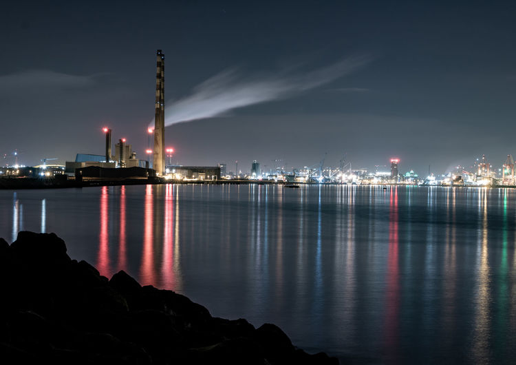 Dublin Bay City River Bay Sea Night Shipyard Shipping  Water Night Illuminated Architecture Built Structure Sky Building Exterior Reflection Waterfront Factory Industry Smoke Stack Nature Sea No People Tower Outdoors Smoke - Physical Structure Pollution Air Pollution