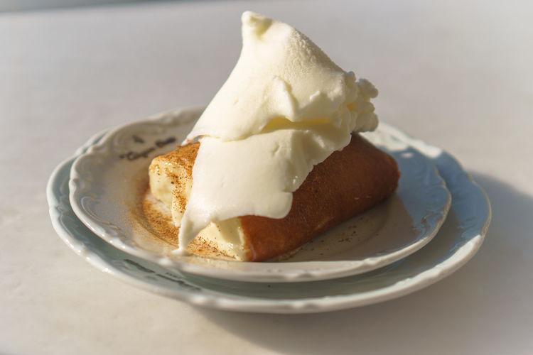 Bread with vanilla ice cream on plate