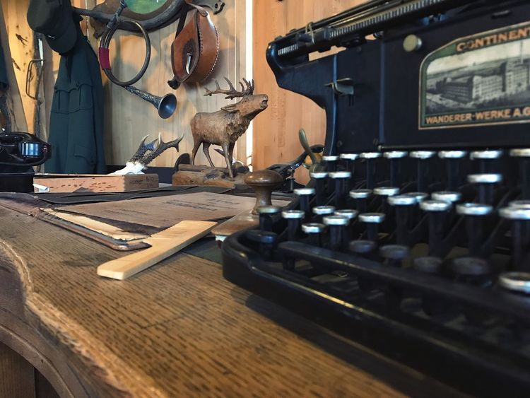 Table Indoors  Wood - Material No People Typewriter Technology Day Close-up Old Vintage Phone Desk Workplace Hunter Forester Forest Hunting Horn Horn Work