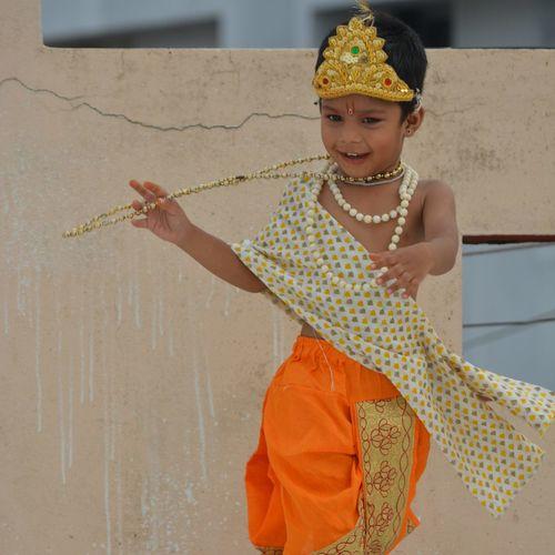 Playing little krishna