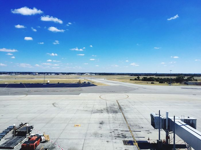 Airport runway against blue sky