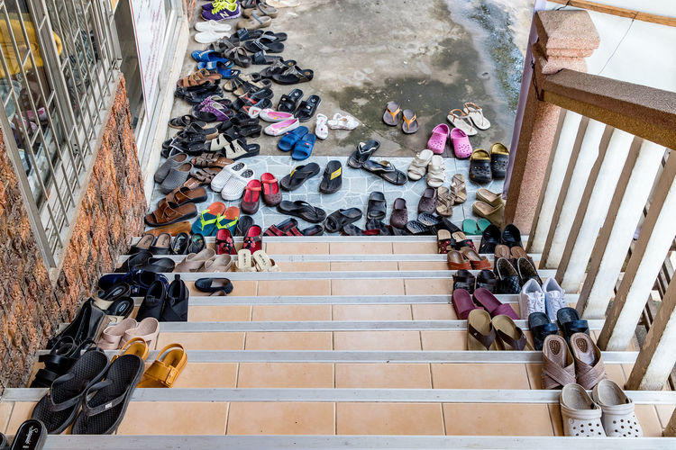 Please take off your shoes. Staircase High Angle View Architecture Steps And Staircases Group Of People Real People Large Group Of People Crowd Day Railing Indoors  Wall - Building Feature Education Built Structure Men Leisure Activity Lifestyles Women No People Southeast Asia Thailand Measure Philanthropy