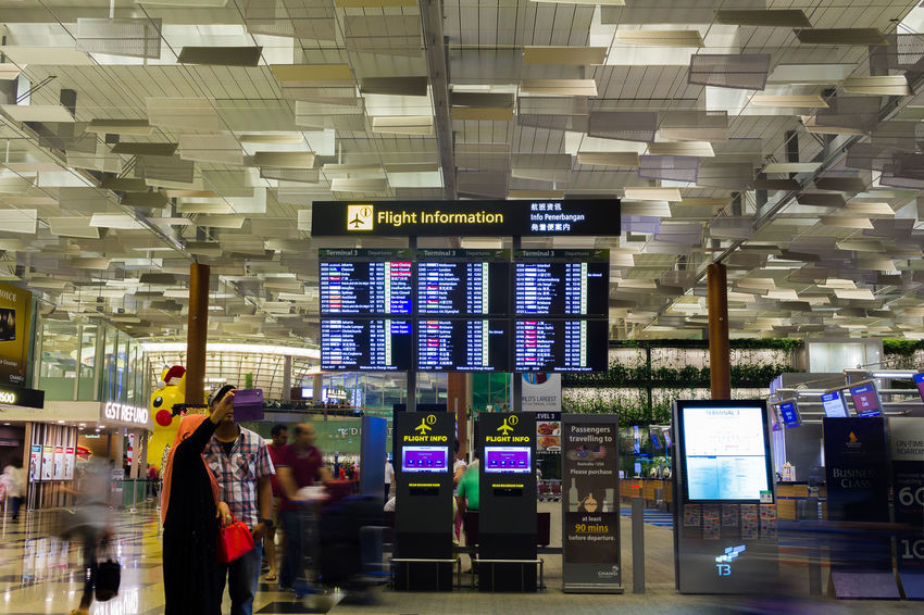 Changi International Airport Adult Adults Only Airport Arrival Departure Board Business Businessman Communication Day Indoors  Men One Man Only One Person Only Men People Technology Text Travel
