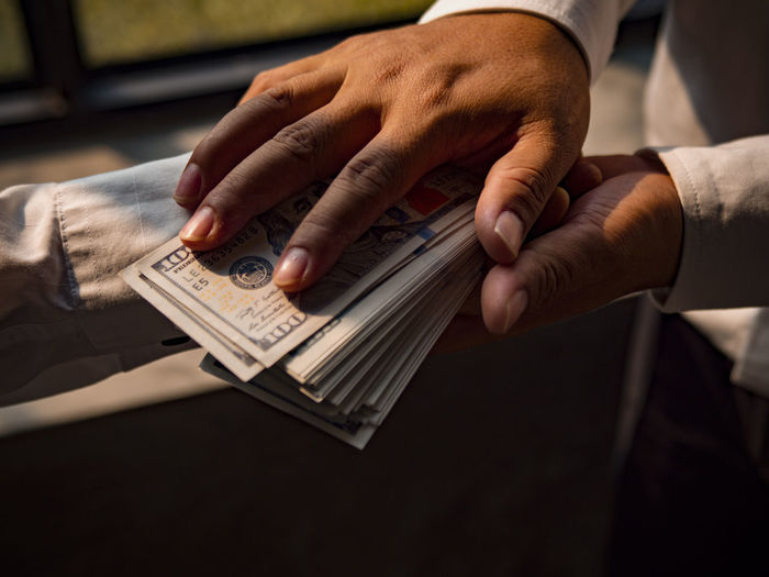Businessmen give money to his partner, business concept. Human Hand Hand Human Body Part Business Finance Indoors  Currency Paper Currency Holding Wealth Close-up People Men Midsection Adult Finger Two People Human Finger Paying Table Consumerism