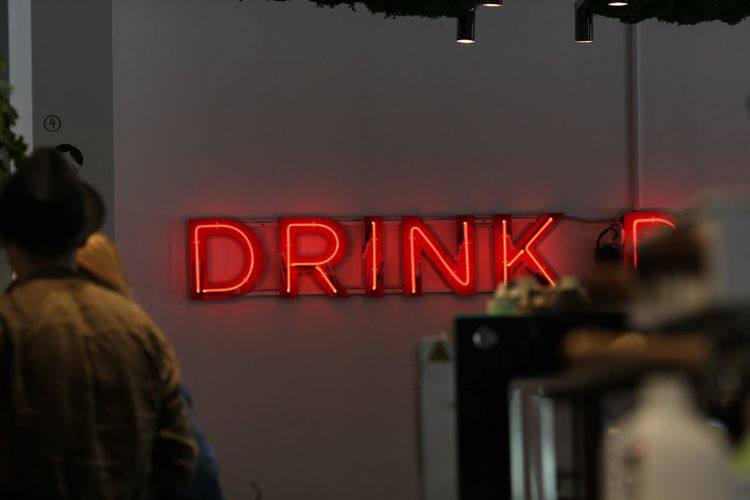 Cafe Coffee Coffee - Drink Text Rear View Communication Sign Western Script Adult Illuminated Healthcare And Medicine Capital Letter Night Entrance Occupation City Travel Leaving Neon Red Indoors  People