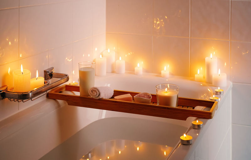 View of illuminated candles in bathroom