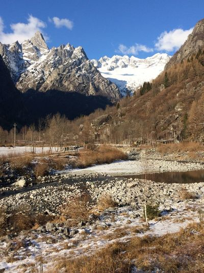 View to cimma di castello, val masino, italy Warmth On Winter Day Afternoon Sunlight River View Val Masino Beauty In Nature Tranquil Scene Outdoors No People Snowcapped Mountain Nature Mountain