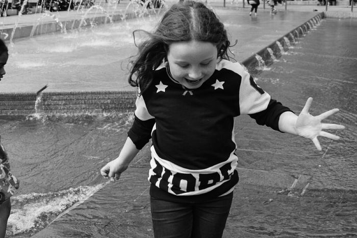 Childhood Real People Girls Three Quarter Length Leisure Activity Casual Clothing One Person Outdoors Fun Day Standing Enjoyment Lifestyles Happiness Child Smiling Nature People Blackandwhite Photography Black And White Photography Blackandwhite Black And White Fountain The Street Photographer - 2017 EyeEm Awards The Street Photographer