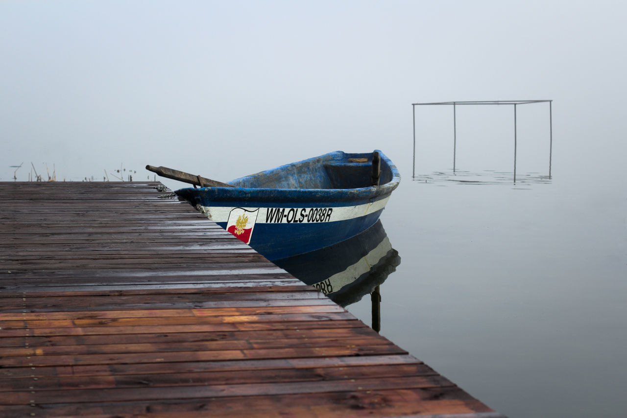 nautical vessel, transportation, mode of transport, water, wood - material, boat, moored, nature, outdoors, no people, lake, day, beauty in nature, scenics, clear sky, sky, longtail boat